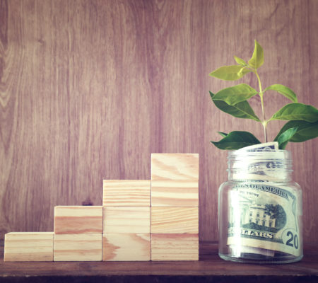 Business image of plant growing in savings jar, money investment and financial growth concept