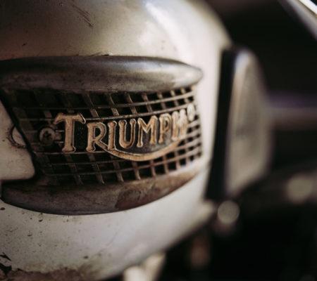 Bangkok, Thailand - April 7, 2019 : Close up Triumph logo brand in motorcycle photos at vintage motorcycle bike in Bangkok, Thailand. triumph motorcycle.Vintage tone.